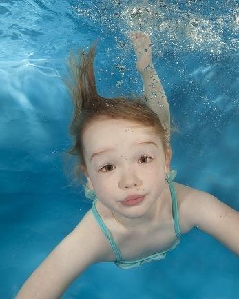 child swimming lesson underwater