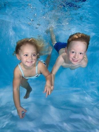 newborn babies underwater swimming