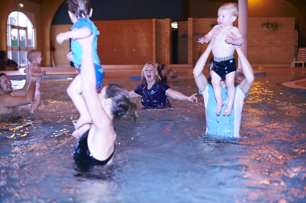children swimming jumping fun