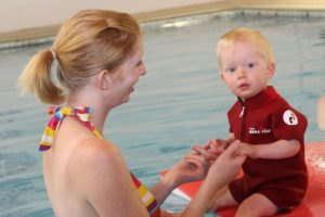 cute child swimming